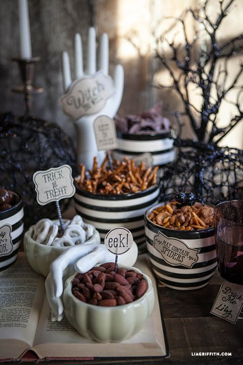"<p>If you're hosting a more casual Halloween affair, you can still deck out your dining table without having fancy schmancy centerpieces. Use designer&nbsp;Lia Griffith's free printables to create a spooky spread of your Halloween apps.&nbsp;</p><p><strong data-redactor-tag=""strong"" data-verified=""redactor"">Get the tutorial at <a href=""http://liagriffith.com/halloween-party-printables/"" target=""_blank"">Lia Griffith</a>.</strong></p>"