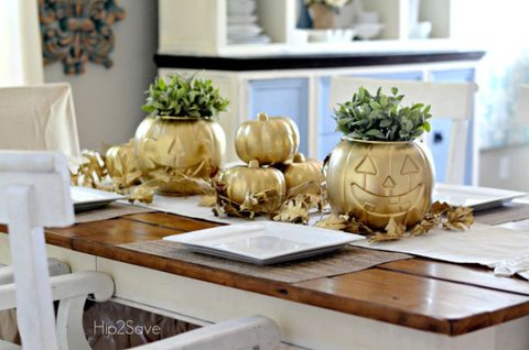 "<p>Make plastic pumpkins stand out with some gold spray paint and pretty greenery.&nbsp;</p><p><strong data-redactor-tag=""strong"" data-verified=""redactor""><a href=""http://www.countryliving.com/diy-crafts/a39982/dollar-store-halloween-hack/"" target=""_blank"">Get the tutorial</a>.</strong> </p>"