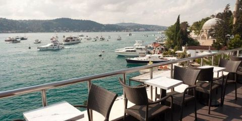 Watercraft, Coastal and oceanic landforms, Furniture, Table, Boat, Outdoor table, Outdoor furniture, Sea, Lake, Restaurant,