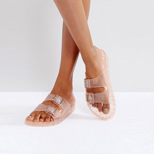"""<p><em data-verified=""""redactor"""" data-redactor-tag=""""em""""><strong data-verified=""""redactor"""" data-redactor-tag=""""strong"""">Bershka Clear Glitter Jelly Sandal, $35</strong></em><span class=""""redactor-invisible-space"""" data-verified=""""redactor"""" data-redactor-tag=""""span"""" data-redactor-class=""""redactor-invisible-space""""><span class=""""redactor-invisible-space"""" data-verified=""""redactor"""" data-redactor-tag=""""span"""" data-redactor-class=""""redactor-invisible-space""""><a href=""""http://us.asos.com/bershka/bershka-clear-glitter-jelly-sandal/prd/8538993"""" target=""""_blank"""" class=""""slide-buy--button"""" data-tracking-id=""""recirc-text-link"""">BUY NOW</a></span></span></p><p><span class=""""redactor-invisible-space"""" data-verified=""""redactor"""" data-redactor-tag=""""span"""" data-redactor-class=""""redactor-invisible-space"""">Many '80s and '90s kids had jelly sandals growing up. Go back to this nostalgic look with this pair in pink glitter.</span></p>"""