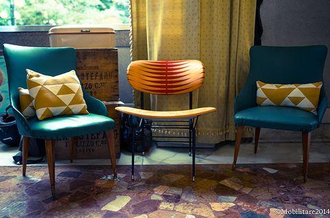 Furniture, Floor, Interior design, Room, Flooring, Chair, Teal, Club chair, Pillow, Throw pillow,
