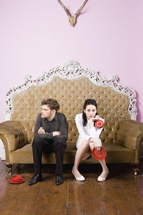 Clothing, Human, Leg, Human body, Trousers, Sitting, Outerwear, Comfort, Interior design, Floor,
