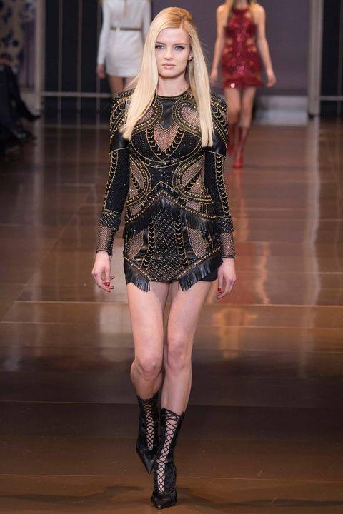 Leg, Shoulder, Floor, Human leg, Fashion show, Joint, Flooring, Fashion model, Waist, Thigh,