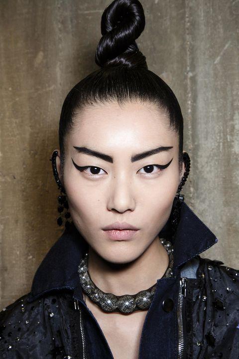 Ear, Hairstyle, Forehead, Eyebrow, Eyelash, Style, Black hair, Fashion accessory, Beauty, Jacket,