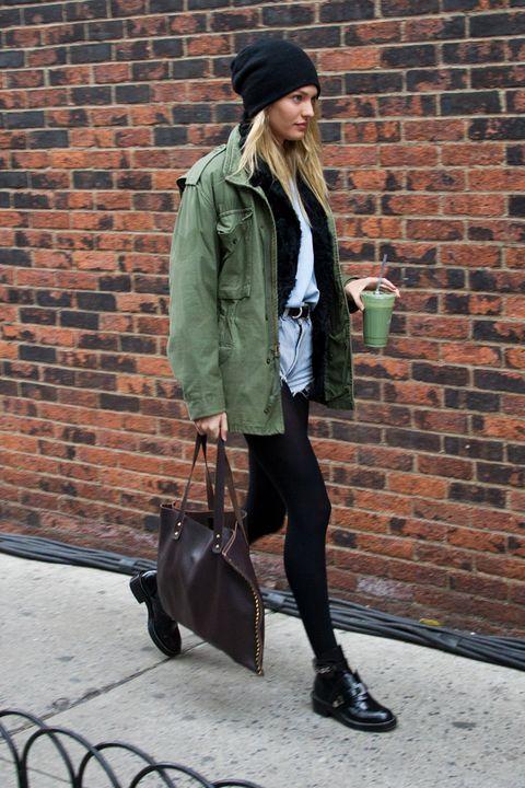 Clothing, Brown, Human body, Brick, Bag, Textile, Outerwear, Jacket, Coat, Hat,