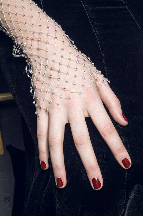 Finger, Skin, Nail, Wrist, Thumb, Nail care, Manicure, Nail polish, Gesture, Body jewelry,