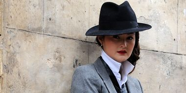 Clothing, Hat, Coat, Collar, Sleeve, Outerwear, Dress shirt, Standing, Formal wear, Style,