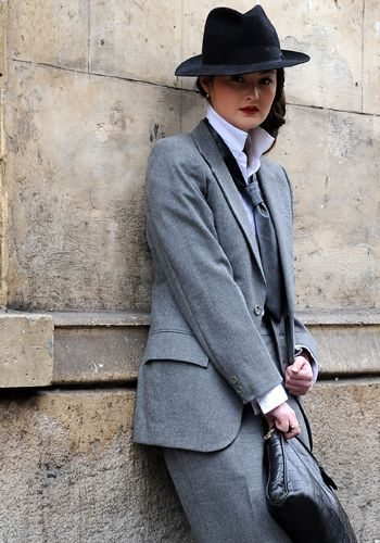 Clothing, Coat, Collar, Sleeve, Trousers, Hat, Dress shirt, Outerwear, Standing, Formal wear,