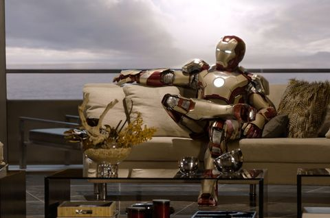 Iron man, Fictional character, Carmine, Armour, Avengers, Sculpture, Toy, Couch, Mecha, Action figure,