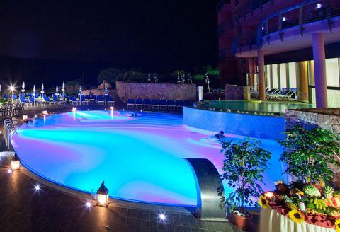 Night, Majorelle blue, Swimming pool, Resort, Design, Hotel, Landscape lighting, Water feature, Boutique hotel, Inn,