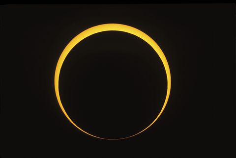 Yellow, Colorfulness, Amber, Circle, Astronomical object, Eclipse, Celestial event, Symbol, Corona,