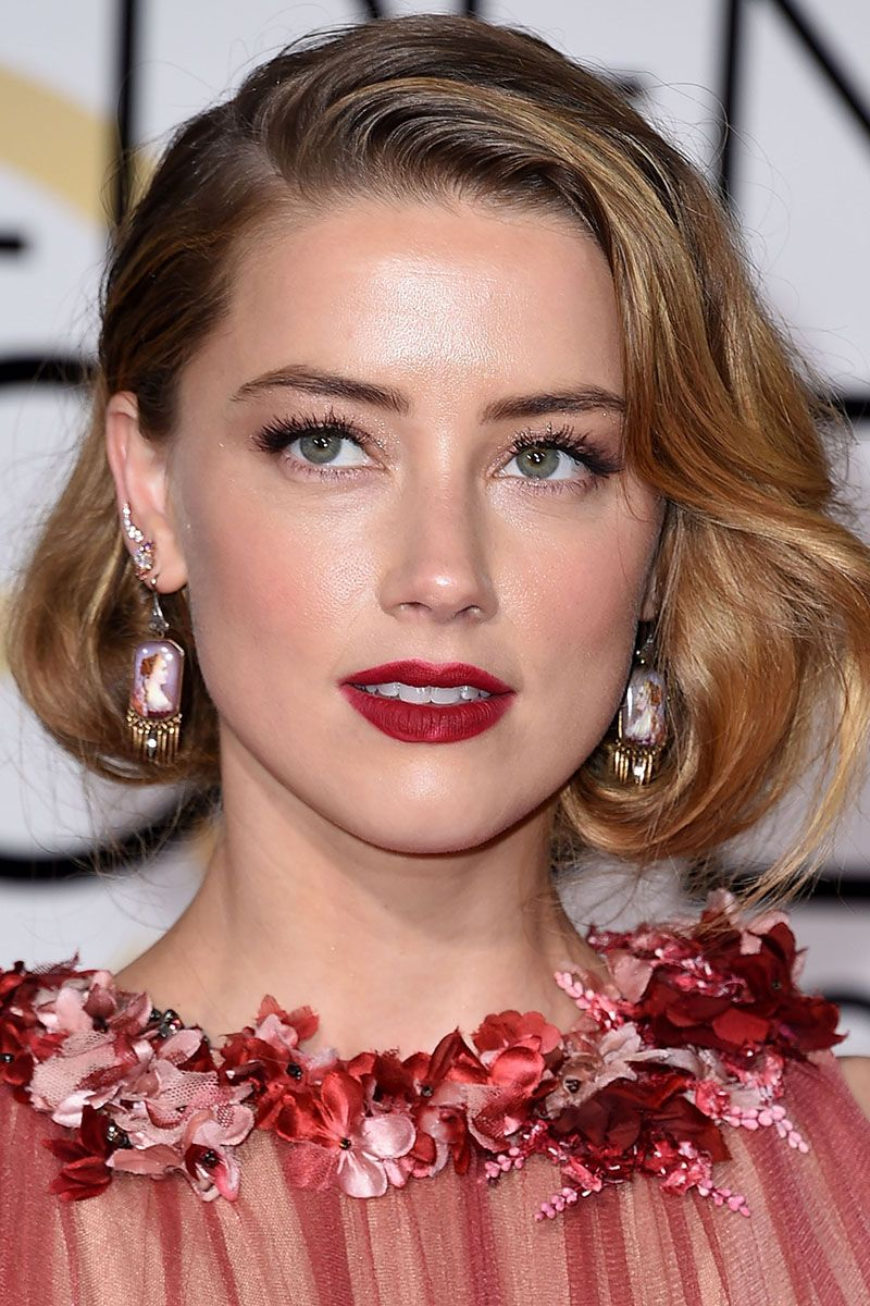 BEVERLY HILLS, CA - JANUARY 10:  Amber Heard arrives at the 73rd Annual Golden Globe Awards at The Beverly Hilton Hotel on January 10, 2016 in Beverly Hills, California.  (Photo by Steve Granitz/WireImage)