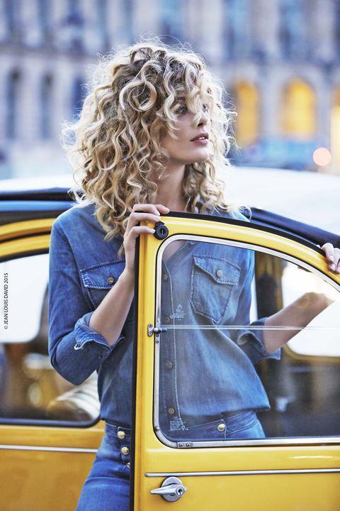 Automotive exterior, Street fashion, Ringlet, Travel, Vehicle door, Long hair, Electric blue, Blond, Brown hair, Automotive window part,
