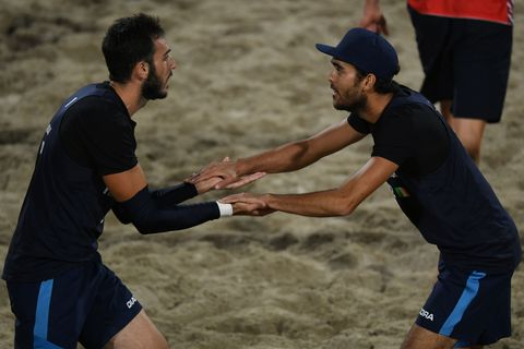Italy's Daniele Lupo (R) and Italy's Paolo Nicolai react during the men's beach volleyball quarter-final match between Russia and  Italy at the Beach Volley Arena in Rio de Janeiro, on August 15, 2016, as part of the Rio 2016 Olympic Games. / AFP / Yasuyoshi Chiba        (Photo credit should read YASUYOSHI CHIBA/AFP/Getty Images)