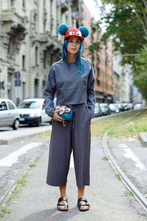 Clothing, Sleeve, Bag, Fashion accessory, Street fashion, Street, Electric blue, Luggage and bags, Waist, Sidewalk,