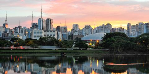 Skyline with reflections on lake at sunrise, Ibirapuera Park, S?o Paulo, Brazil.