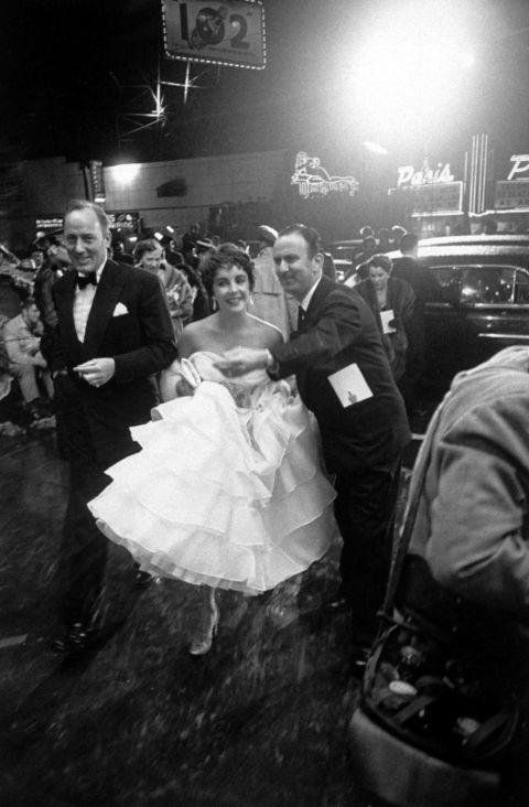 Dress, Trousers, Bridal clothing, Shirt, Photograph, Coat, Suit, Gown, Mammal, Bride,