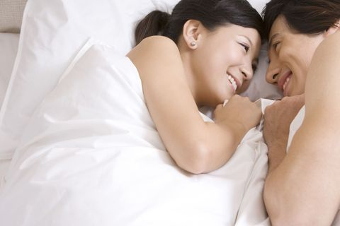 smiling couple on the bed