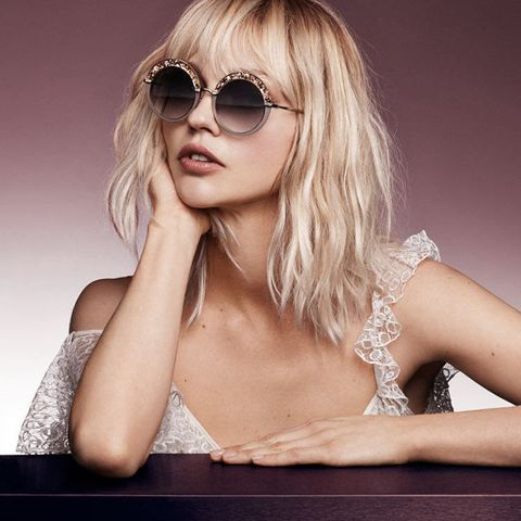 Eyewear, Glasses, Vision care, Lip, Hairstyle, Skin, Sunglasses, Shoulder, Joint, Fashion model,