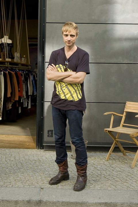 Denim, Shoe, Textile, Outerwear, Jeans, T-shirt, Boot, Clothes hanger, Street fashion, Fashion,