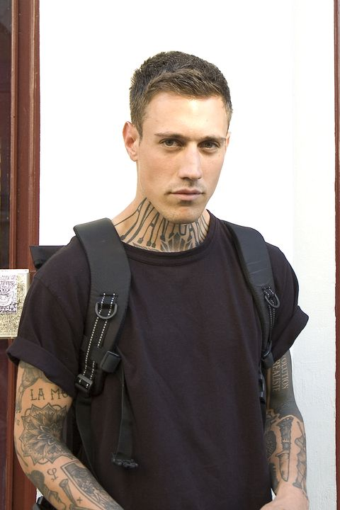 Hairstyle, Shoulder, Style, Crew cut, Chest, Trunk, Buzz cut, Mohawk hairstyle, Tattoo, High and tight,