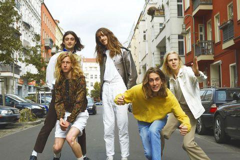 Leg, Trousers, Window, Land vehicle, Jacket, Shirt, Jeans, Road, Outerwear, Street,