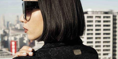 Eyewear, Vision care, Goggles, Black hair, Street fashion, Costume accessory, Cool, Sunglasses, Tower block, Condominium,