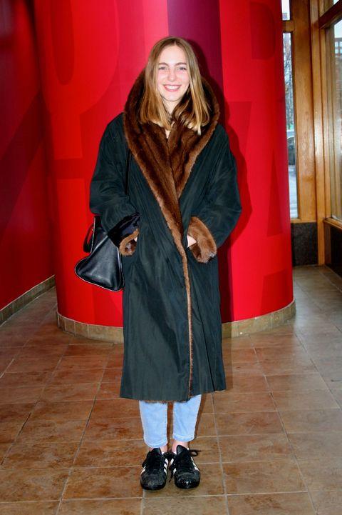 Sleeve, Textile, Floor, Outerwear, Red, Flooring, Style, Fashion, Street fashion, Knee,