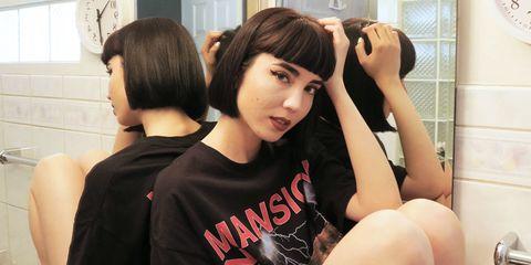 Hairstyle, Shoulder, Plumbing fixture, Room, Elbow, Black hair, Comfort, Bangs, Plumbing, Long hair,