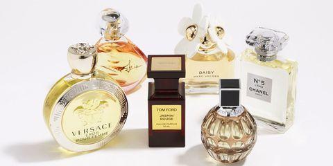 Perfume, Cosmetics, Bottle, Lavender, Beige, Natural material, Circle, Label, Glass bottle, Peach,