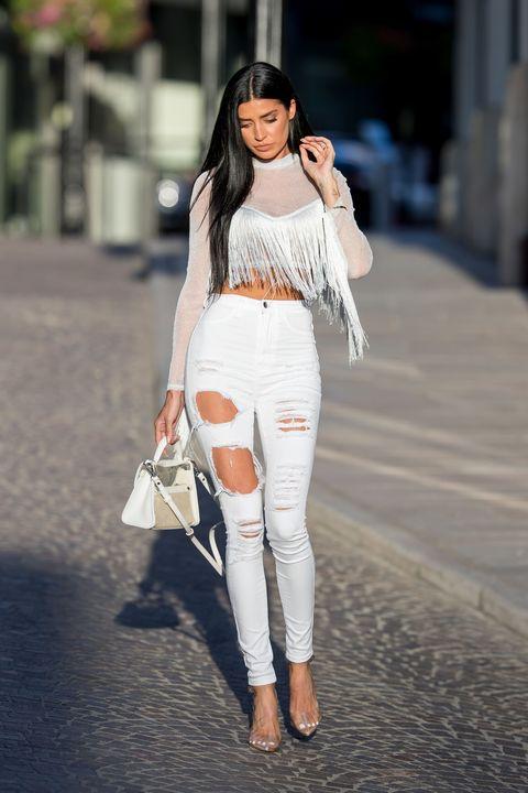 White, Clothing, Street fashion, Shoulder, Fashion, Jeans, Fashion model, Beauty, Waist, Crop top,
