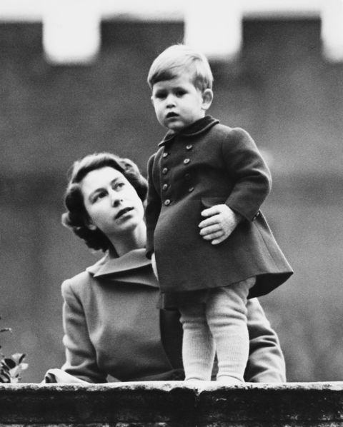 Princess Elizabeth (later Queen Elizabeth II) and Prince Charles watching a procession, during the visit of Queen Juliana of the Netherlands, from the wall of Clarence House, London, 22nd November 1950. (Photo by Fox Photos/Hulton Archive/Getty Images)