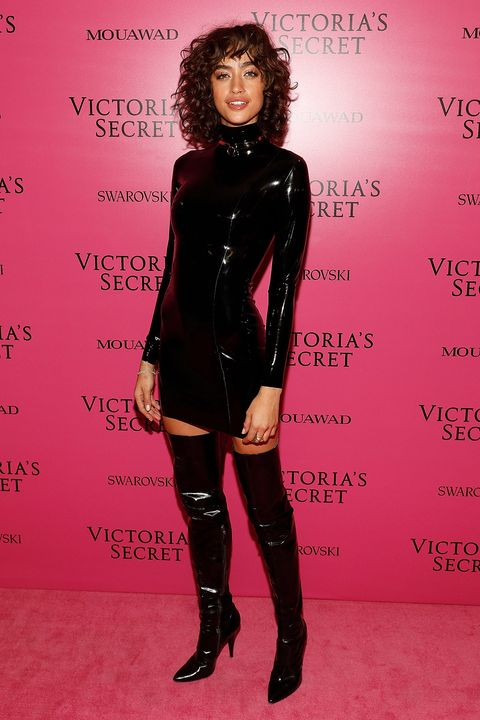 Latex clothing, Clothing, Latex, Pink, Footwear, Leg, Joint, Dress, Thigh, Leather,