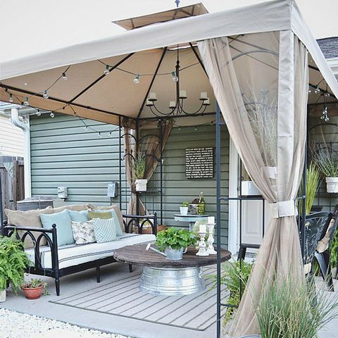Flowerpot, Outdoor furniture, Real estate, Shade, Couch, Home, Houseplant, Coffee table, Outdoor table, Patio,