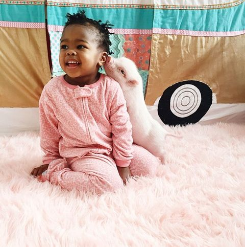 Human, Skin, Happy, Baby & toddler clothing, Sitting, Toddler, Comfort, Fur, Tooth, Laugh,
