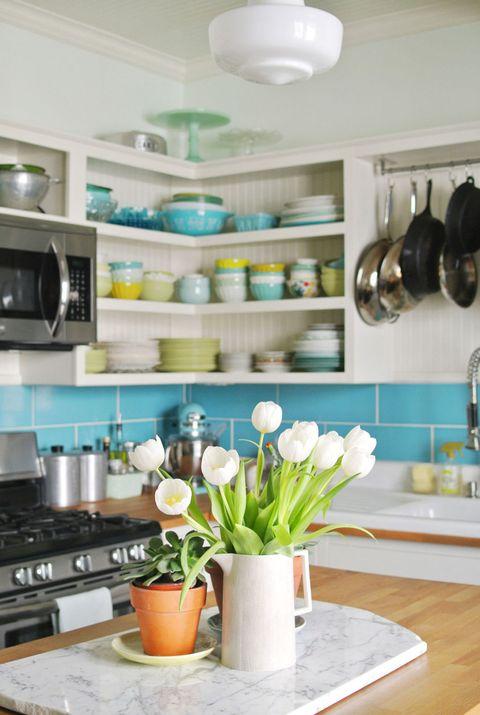 Room, Interior design, Major appliance, Interior design, Flowerpot, Kitchen stove, Bouquet, Turquoise, Shelving, Gas stove,