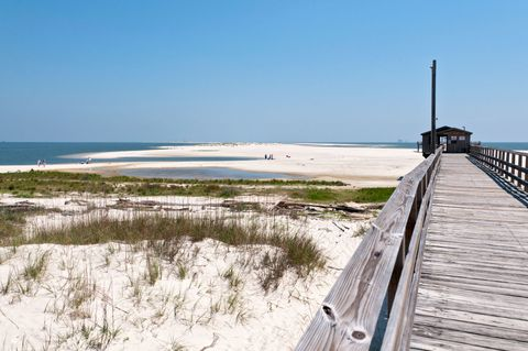 Coastal and oceanic landforms, Shore, Coast, Sand, Horizon, Boardwalk, Beach, Walkway, Wetland, Dock,