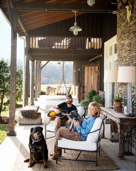 ronnie dunn and his wife, janine, relax on their porch