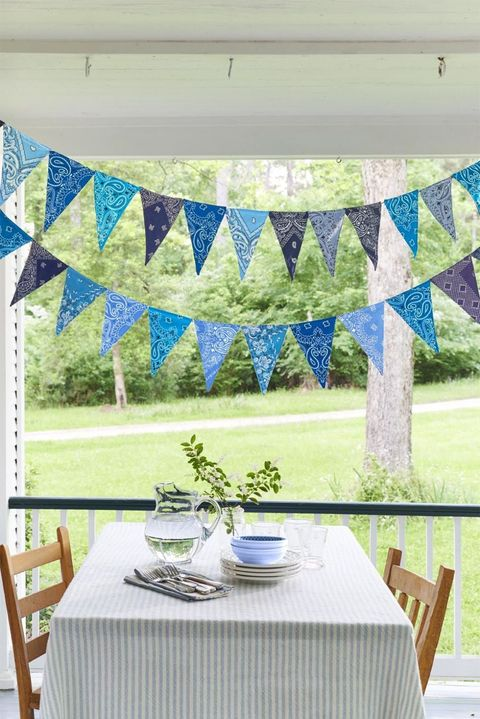 Textile, Turquoise, Tablecloth, Interior design, Table, Room, Linens, Window valance, Furniture, Pattern,