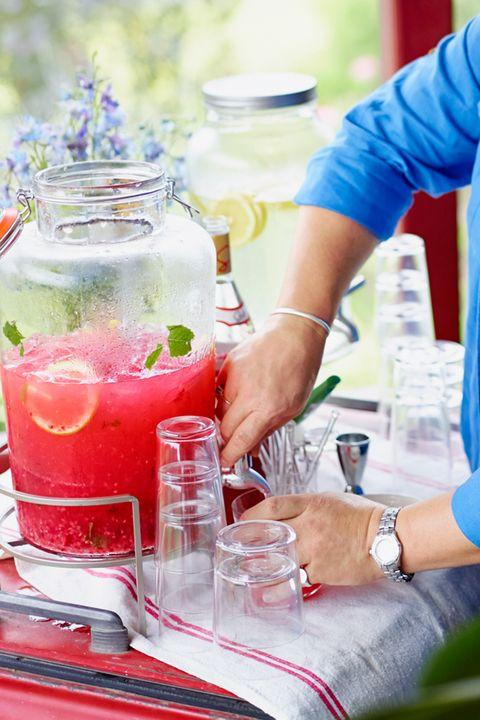 Hand, Watch, Liquid, Juice, Drink, Wrist, Cocktail, Ingredient, Sea breeze, Daiquiri,