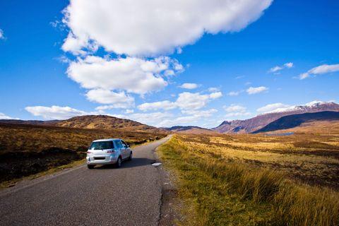 Motor vehicle, Automotive mirror, Road, Automotive design, Cloud, Infrastructure, Mountainous landforms, Automotive exterior, Automotive lighting, Highland,