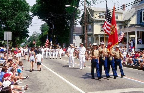 Footwear, Event, Crowd, Flag, Pole, Parade, Public event, Pedestrian, Festival, Flag of the united states,