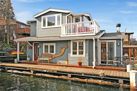 Property, House, Real estate, Home, Residential area, Roof, Siding, Porch, Channel, Cottage,