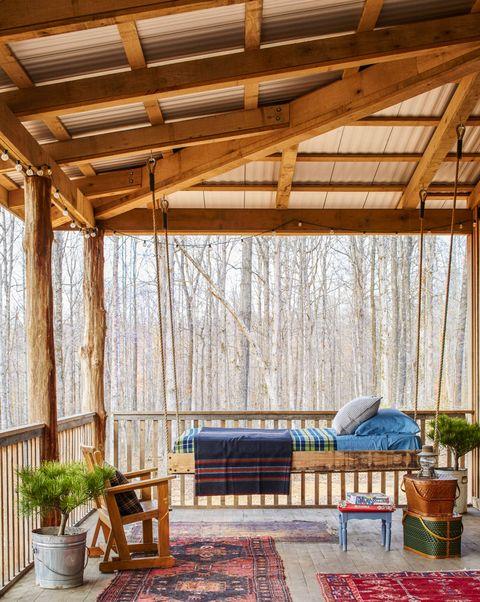 Wood, Flowerpot, Furniture, Hardwood, Beam, Outdoor furniture, Shade, Houseplant, Outdoor structure, Pergola,
