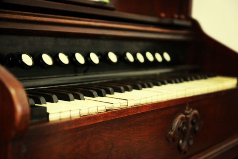 Musical instrument, Keyboard, Music, Musical instrument accessory, Light, Piano, Black, Hardwood, Wood stain, Musical keyboard,