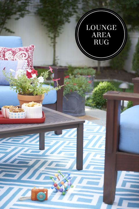 "<p>An all-weather woven rug provides cushioning for unsteady feet and defines the patio seating area for lounging and entertaining. A fade- and water-resistant mat is ideal for sunny- and salty-air climes. </p><p><em>Threshold Target outdoor rug, <a href=""http://www.target.com/p/threshold-indoor-outdoor-flatweave-area-rug-blue/-/A-14960233#prodSlot=medium_1_1&term=066042632"" target=""_blank"">target.com</a>; Paul Greif bowl, <a href=""http://www.paulagreifceramics.com/"" target=""_blank"">paulagreifceramics.com</a>; Plan Toys My First Camera, <a href=""http://www.giggle.com/my-first-camera/PLNM564.html"" target=""_blank"">giggle.com</a></em><br></p>"