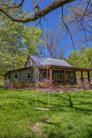 Grass, Branch, Property, Land lot, Real estate, House, Roof, Woody plant, Home, Rural area,