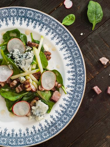 """<p>Creamy and crunchy, hearty and light: This starter is a symphony of delectable contradictions. And kudos to Edward Lee for the ingeniously toothsome pairing of green apples and breakfast radishes.</p> <p><strong> Recipe:</strong> <a href=""""http://www.countryliving.com/recipefinder/spinach-salad-bacon-blue-cheese-bourbon-vinaigrette-recipe-clv0513"""" target=""""_blank"""">Spinach Salad with Bacon, Blue Cheese, and Bourbon Vinaigrette</a></p>"""
