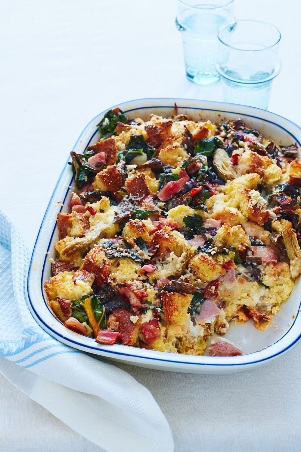 """<p>Hearty and impressive, this savory egg-based casserole is the perfect addition to your buffet table. (Bonus: You can do most of the prep the night before!)</p><p><strong>Recipe</strong>: <a href=""""http://www.countryliving.com/food-drinks/recipes/a34293/breakfast-bread-pudding-recipe-wdy0414/ """" target=""""_blank"""">Breakfast Bread Pudding</a><br></p>"""