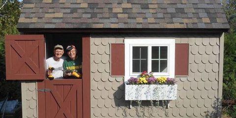 Wall, House, T-shirt, Door, Flowerpot, Roof, Fixture, Houseplant, Home door, Stone wall,